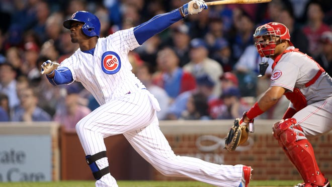 Jorge Soler hits a home run during the first inning at Wrigley Field.