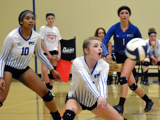 Mesilla Valley Christian's Annika Conn goes for a dig