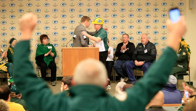 Frank Lamping of Union Grove hugs Green Bay Packers President/CEO Mark Murphy after being named the 19th member of the Packers Fan Hall of Fame at Lambeau Field on Tuesday, Feb. 14, 2017.