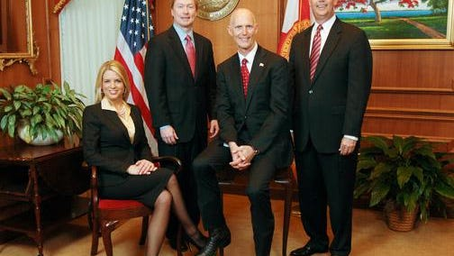 From left, Florida Attorney General Pam Bondi, Agricultural Commissioner Adam Putnam, Gov. Rick Scott and Chief Financial Officer Jeff Atwater pose for a photo.