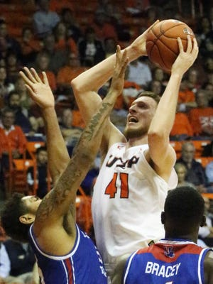 UTEP center Matt Willms gets up over Jeremiah Taylor, left, of Louisiana Tech for a shot Thursday night in the Don Haskins Center. The Miners were edged out by the Bulldogs 62-61.