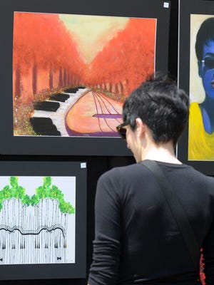 A browser looks over some art at the second annual Dewey Beach Arts Festival.