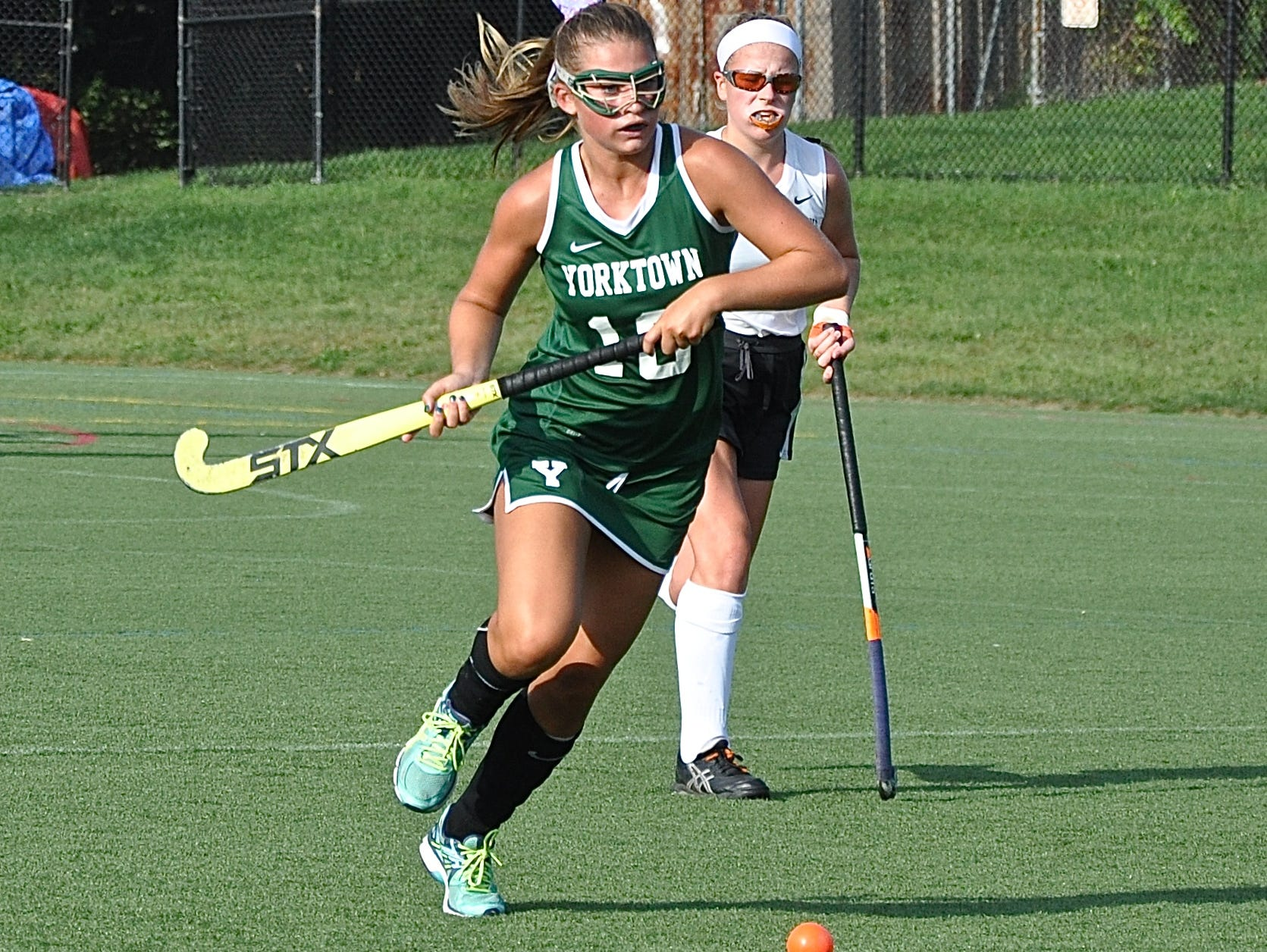 Yorktown's Katie Vogel carries the ball up the field against Pawling.