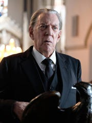 Donald Sutherland, seen here playing billionaire J.