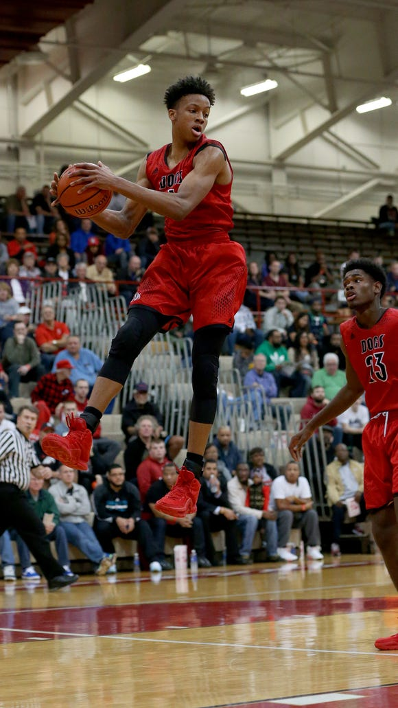 New AlbanyÕs Romeo Langford (1) pulls in a rebound during the Tip Off Classic on Dec. 12, 2015.