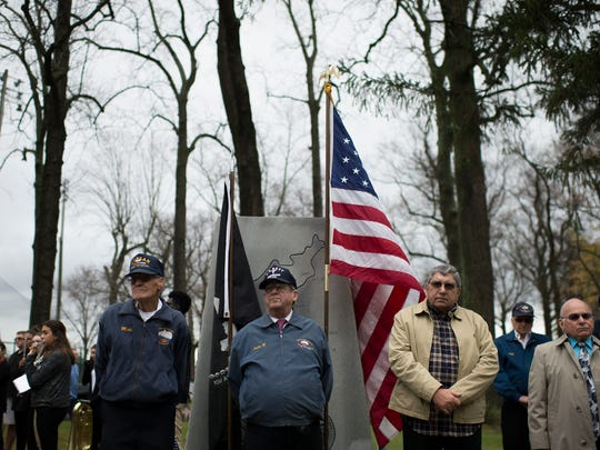 Veterans and community members gather as a Veterans