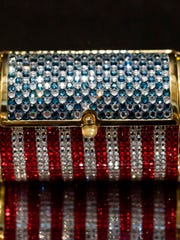 "This undated photo provided by the Museum of Arts and Design shows a minaudière by Judith Leiber, which was made in 1976 to celebrate the occasion of the American bicentennial. It is part of the exhibit ""Judith Leiber: Crafting a New York Story."" (Jenna Bascom/Museum of Arts and Design via AP)"