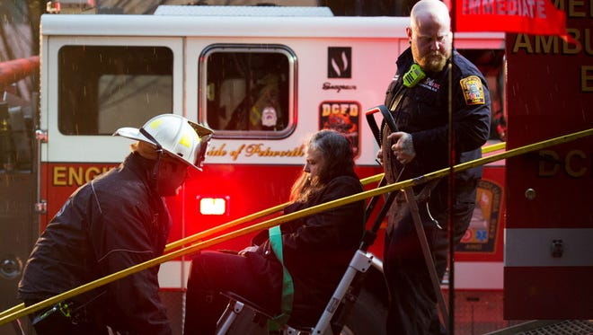 Firefighters in Washington, D.C., load a victim into a medical bus after passengers on a subway car on Jan. 12, 2015, were injured when smoke filled the L'Enfant Plaza station during rush hour.
