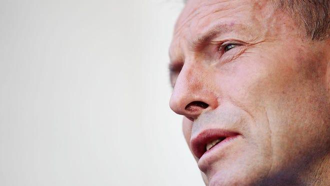 Former Australian Prime Minister Tony Abbott hasn't gone away.