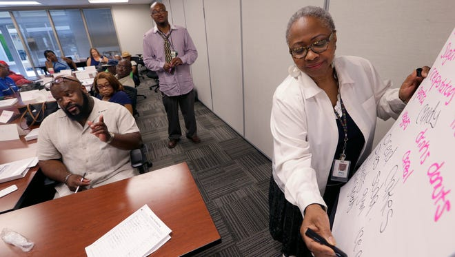 Carol Witcher (right) leads a brainstorming session during a diabetes management class for middle-aged and older clients of the health program iCare Tuesday in Milwaukee. The health care agency offers the six-week course five times a year.