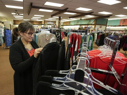 Angie Bonk, Schroeder's ladies buyer, arranges a rack