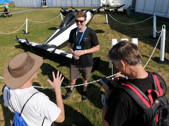 Frank Perkins of Opener based in Palo Alto, talks to spectators about the BlackFly version 2 flying car based in Palo Alto, California Tuesday, July 24, 2018, in Oshkosh, Wis.  The 66th annual Experimental Aircraft Association Fly-In Convention, AirVenture 2018 draws over 500,000 people annually to the area.  The convention runs through July 29.Joe Sienkiewicz/USA Today NETWORK-Wisconsin