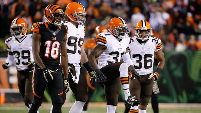 The Cleveland Browns strong safety Donte Whitner (31) reacts after breaking up a pass to the Cincinnati Bengals wide receiver A.J. Green (18) at Paul Brown Stadium.  The Enquirer/Jeff Swinger