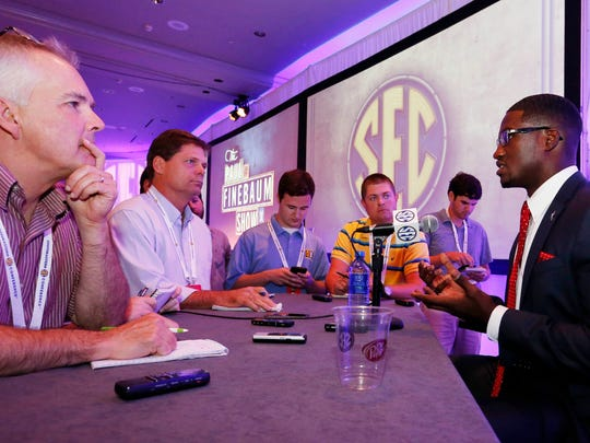 Vanderbilt player Oren Burks, right, speaks at SEC Media Days on July 11, 2016.