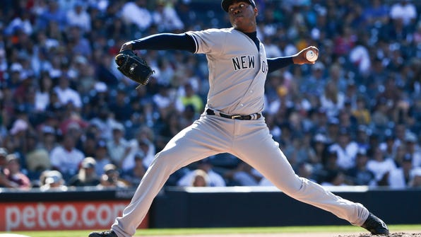 FILE - In this July 3, 2016, file photo, New York Yankees reliever Aroldis Chapman pitches in the ninth inning against the San Diego Padres in a baseball game, in San Diego. With all those 100 mph fastballs flying through the strike zone these days from Chapman, Noah Syndergaard and others, flame-throwers are the norm rather than the exception _ in rotations and bullpens alike. (AP Photo/Lenny Ignelzi, File)