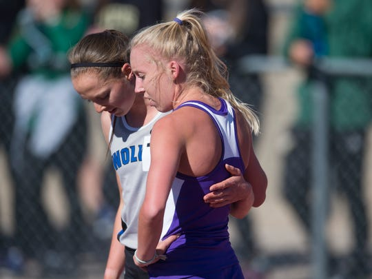 Fort Collins High School's Lauren Gregory, right, gets a hug from Brie Oakley of Grandview following the 5A girls 3200-meter run during the CHSAA State Track and Field Championships at JeffCo Stadium in Lakewood on Saturday, May 20, 2017. Oakley finished ahead of Gregory to shatter the state record.