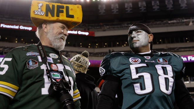 Fans talk before an NFL football game between the Philadelphia Eagles and the Green Bay Packers, Monday, Nov. 28, 2016, in Philadelphia. (AP Photo/Matt Rourke) ORG XMIT: _1MR6218
