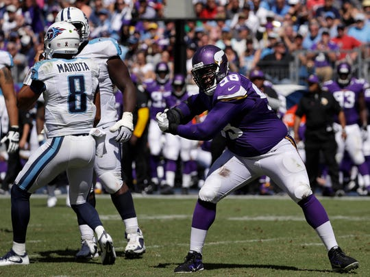 Minnesota Vikings defensive tackle Linval Joseph (98) celebrates after sacking Tennessee Titans quarterback Marcus Mariota (8) for a 9-yard loss in the second half of an NFL football game Sunday, Sept. 11, 2016, in Nashville, Tenn.