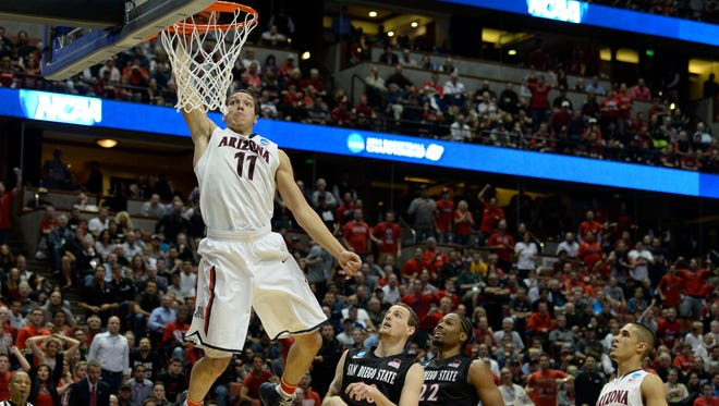 Arizona forward Aaron Gordon (11) dunks the ball past San Diego State forward Matt Shrigley (40) during the second half of their NCAA Tournament Sweet 16 game on Thursday.