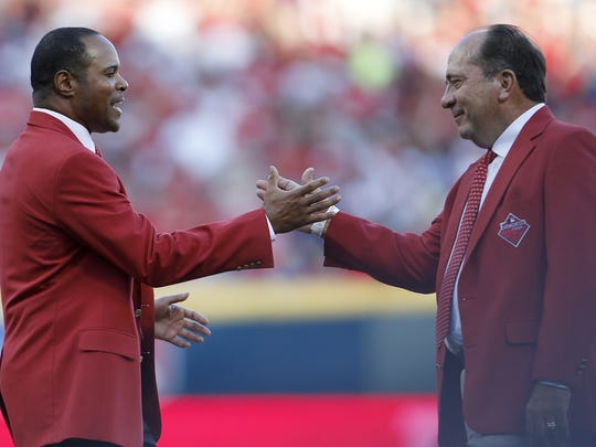 Reds greats and Hall of Famers Barry Larkin, left,