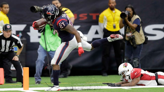 Houston Texans running back D'Onta Foreman (27) scores on a 34-yard run during the second half of an NFL football game against the Arizona Cardinals, Sunday, Nov. 19, 2017, in Houston. Foreman was injured on the play.