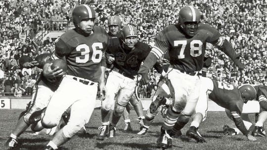 "Known as the ""60-minute man,"" Coleman (78) was MSU's"