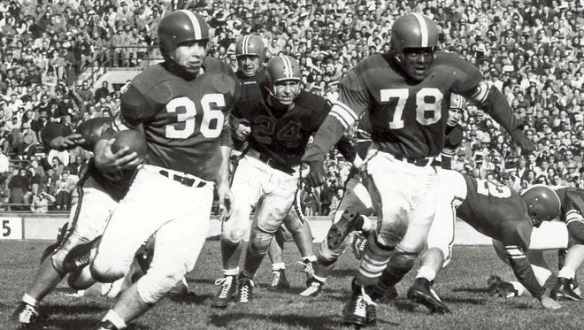 "Known as the ""60-minute man,"" Coleman (78) was MSU's first unanimous All-American in 1951."