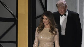 The future first lady donned gold the night before the inauguration.