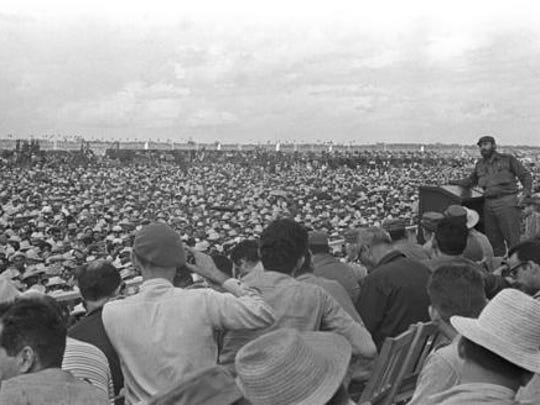 FILE - In this Oct. 1967 file photo, Cuba's leader Fidel Castro, top right, delivers a speech during a rally in Bayamo, Cuba. Castro has died at age 90. President Raul Castro said on state television that his older brother died late Friday, Nov. 25, 2016.