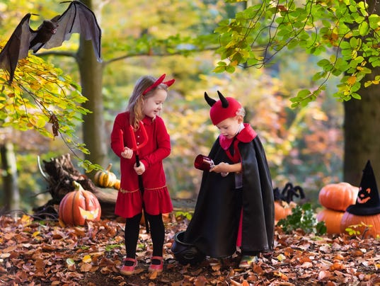 Kids on Halloween wearing devil and vampire costume