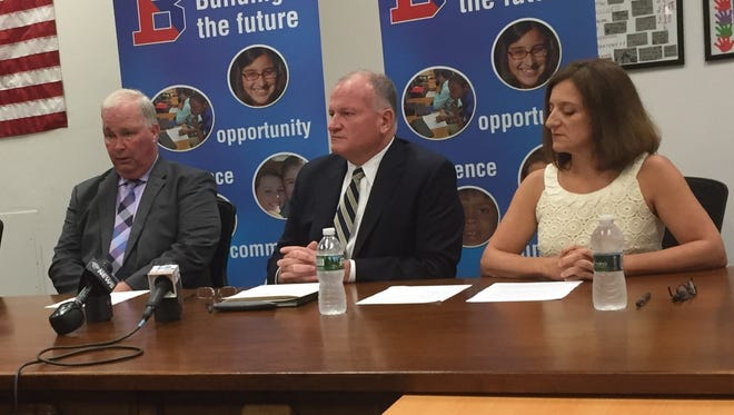 Binghamton school board Vice President Brian Whalen, former interim Superintendent Steve Deinhardt and new interim Superintendent Tonia Thompson speak at a news conference Thursday.