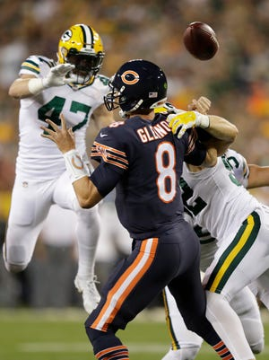 Green Bay Packers outside linebacker Clay Matthews (52) sacks Chicago Bears quarterback Mike Glennon (8) forcing him to fumble the ball during the first half at Lambeau Field.