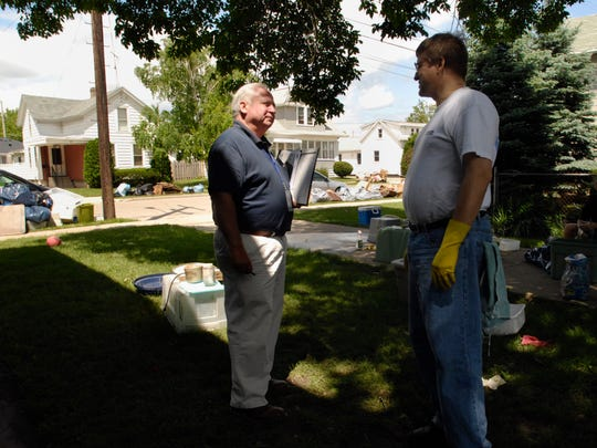 Federal Emergency Management Agency's construction analyst Joseph Combes, left, interviews Oshkosh resident Steve Blum while touring Oshkosh for assessing storm-related damages Monday, June 16, 2008.  FEMA officers' visit is another step toward a disaster declaration for federal assistance.