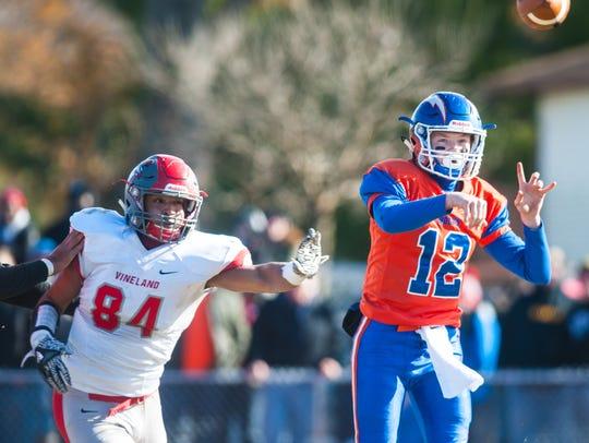 Millville quarterback Tristan Harris (12) drops passes
