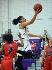 LSUA's Kayla Morgan (31, center) goes for two against the University of the Southwest's Naomi Solsberry (4, left) and  Mikaela Ochoa (23, right) Saturday at the Fort.