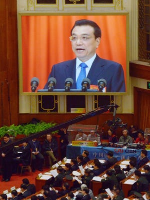 Chinese Premier Li Keqiang is displayed on a screen during the opening session of the 12th National People's Congress in Beijing on March 5.
