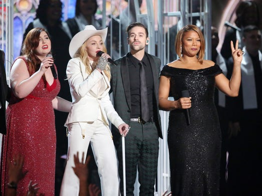 "The 56th annual Grammy Awards hosted a wedding ceremony during the show in which 33 same-sex and straight couples (including one couple from Fishers, Ind.) in the audience were married. The couples were wed during a performance of the song ""Same Love"" by Macklemore (from left), Mary Lambert, Madonna, Ryan Lewis and Queen Latifah"