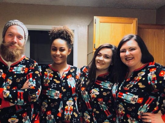 Jarreth, Xana, Gabbi and Racheal Hunt wear matching pajamas each Christmas, as part of their new family tradition.