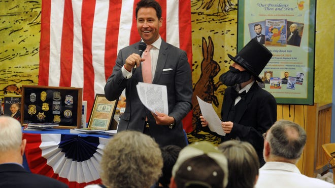 Pensacola Mayor Ashton Hayward reads the Gettysburg Address with Abraham Lincoln (Brandon Fulater) Saturday during the Presidents' Day Book Fair at Barnes & Noble.