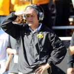 """With all due respect, we don't have anyone that's going to run for 400 yards, so we need to utilize everyone,"" Iowa coach Kirk Ferentz said."