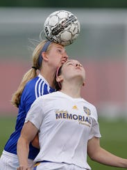 Green Bay Notre Dame forward Grace Shaw (9) battles