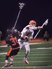 Central's Ryan Fahs (1) powers past Suburban's Phinean