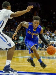 Delaware's Kory Holden drives to the basket in the