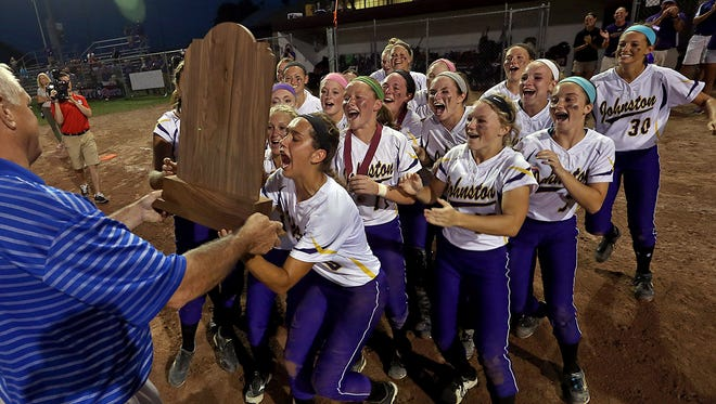 Johnston players run to collect their trophy after 10- 2 win over Southeast Polk in Class 5-A championship game at the 2014 Girls State Softball Tournament in Ft. Dodge on Friday.