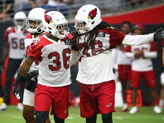 Arizona Cardinals safety Budda Baker and safety Tre
