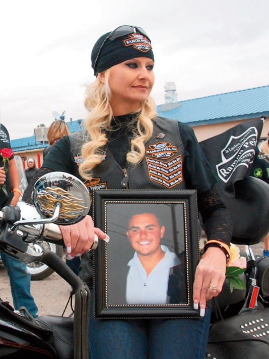 "Headlight File Photo   Natasha Jasso holds a portrait of her late son, Ramon ""Momo"" Pena III, prior to heading out on last year's Rockin The Streets Bike Run in memory of her son. This year marks the sixth annual RTS run. To date, the event has raised over 35,000 in support of Deming High scholarships and various charitable causes in the community."