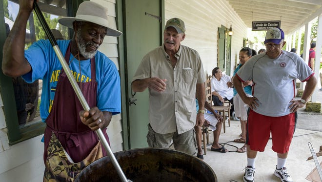 Edmond Alexander Jr. demonstrates cracklin cooking during Creole Culture Day at Vermilionville.