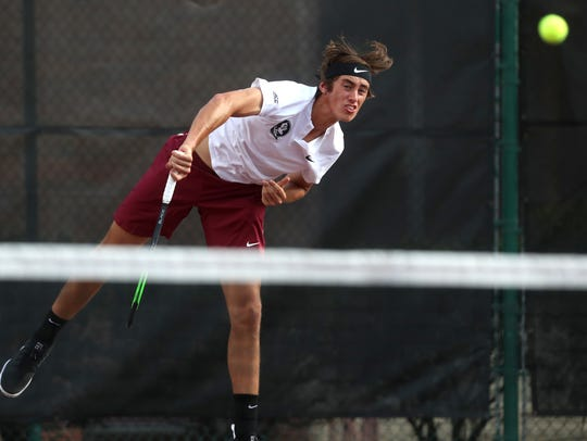 FSU's Alex Knaff serves the ball against Alabama State