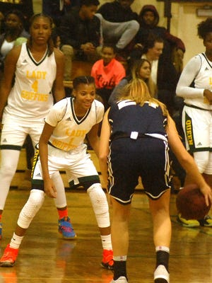 Queen of Peace girls basketball has been strong on defense led by junior Forever Toppin (1) and senior Raven Farley-Clarke (4).