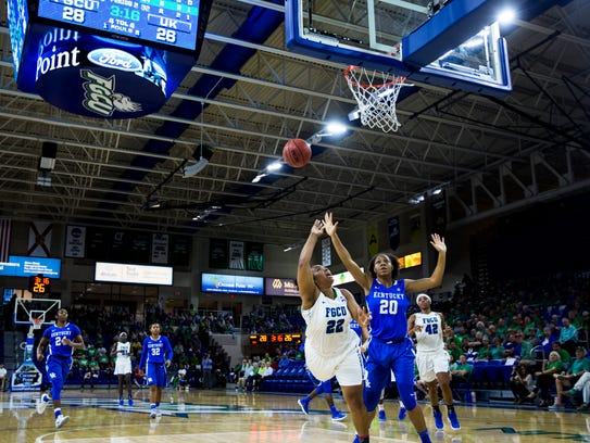 Florida Gulf Coast University guard China Dow (22) lays the ball up during the game against University of Kentucky at Alico Arena in Fort Myers on Friday. The Eagles defeated the Wildcats 70-64.